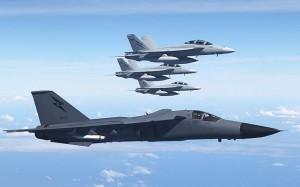 F-111C A8-125 escorts three of five RAAF FA-18F Super Hornets into RAAF Base Amberley. (photo - Paul Sadler)