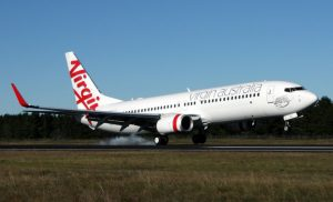 A Virgin Australia passenger who allegedly sparked a hijack scare on a  flight from Brisbane to Bali is being returned to Australia. (Paul Robson)