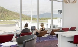 The new Virgin Australia lounge in Cairns offers panoramic views over the runway and surrounding hills.