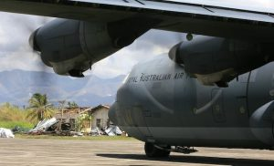 A RAAF C-130J prepares to taxi out of Ormoc airport. (Defence)