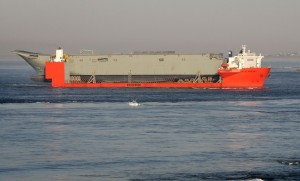 The hull of LHD02 arrives in Melbourne aboard the MV Blue Marlin. (Defence)