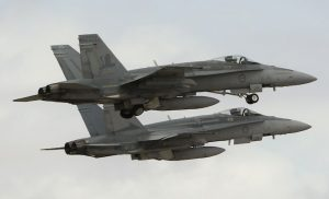 Two 75SQN operated Hornets depart Andersen AFB during Cope North 14. (Defence)