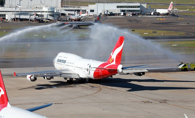 VH-OEF is farewelled from Sydney with an ARFF monitor cross. (Mike Prendergast)