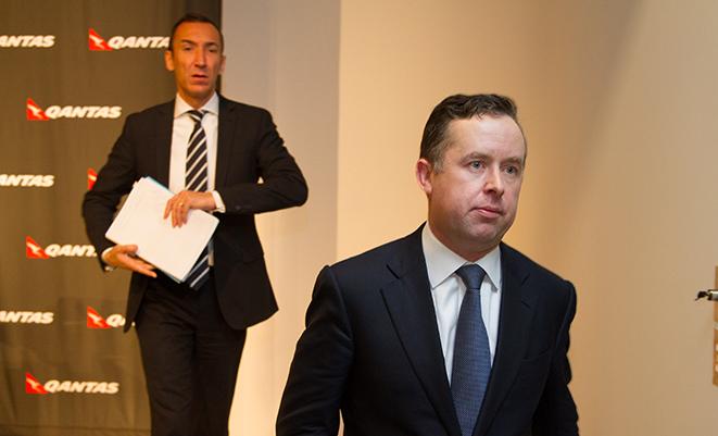Alan Joyce leaves Thursday's press conference. (Seth Jaworski)