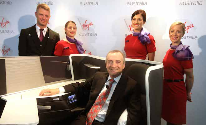 Virgin Australia chief executive John Borghetti unveils the airline's new business class seat. (Geoffrey Thomas)
