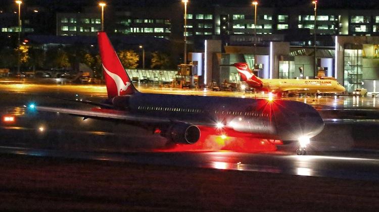 VH-OGM, a Qantas 767, lands at Canberra Airport. (Paul Sadler)