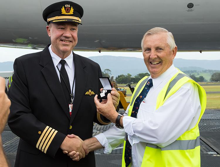 "Captain Greg Matthews hands over the ""keys"" to VH-OJA to HARS president Bob De La Hunty. (Seth Jaworski)"
