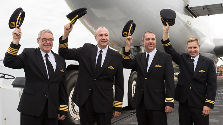 The four pilots on VH-OJA's final flight recreate the pose from the end of the aircraft's record-breaking delivery flight in 1989. (Seth Jaworski)