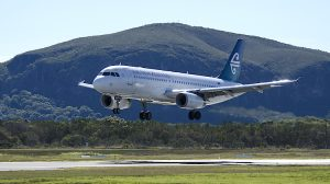 An Air NZ Airbus A320 at Sunshine Coast Airport with Mt Coolum in the background. (Sunshine Coast Airport)