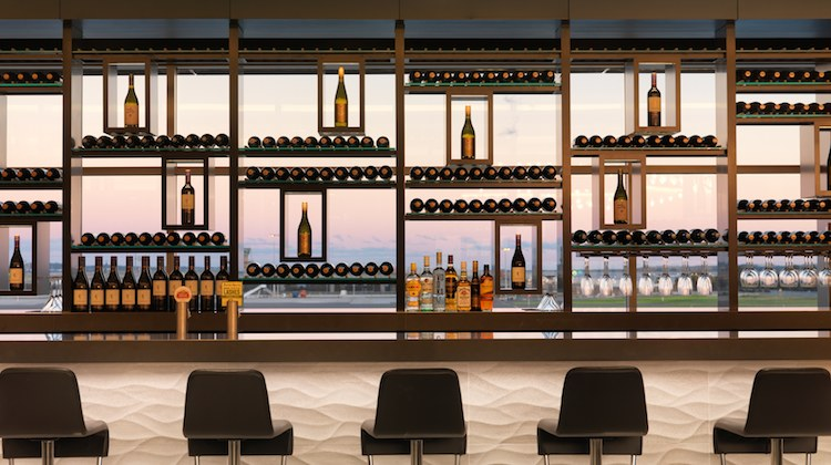 Air NZ's Sydney lounge features a glass backed wine rack that looks out onto the airfield. (Air NZ)