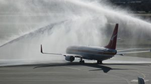 Qantas's Boeing 737-800 VH-XZP departs Perth Airport to a water cannon salute for the resumption of the airline's Perth-Singapore service on June 26 2015. (Chris Frame)