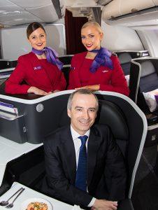 Virgin Australia chief executive John Borghetti models the new business class seats. (Seth Jaworski)