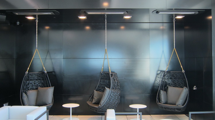 "The architects of the Air NZ Auckland international lounge say the hanging chairs are ""a bit of fun"". (Jordan Chong)"