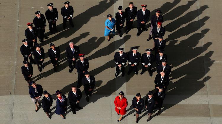 Past and present British Airways crew celebrate the Queen. (British Airways/Geoff Caddick-Press Association)