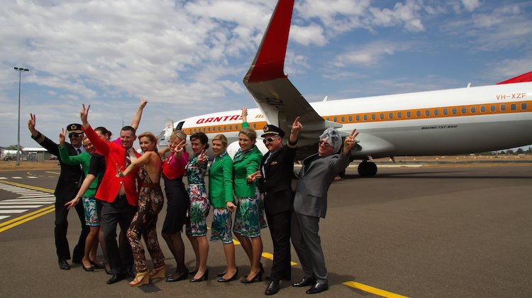 Qantas staff get into the spirit of things at the airline's charity flight to Longreach. (Dave Parer)