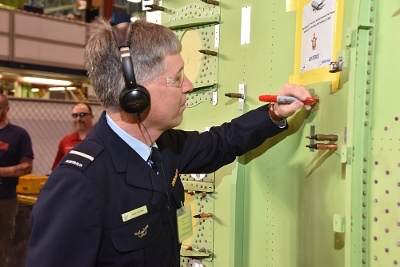 AIRCDRE Brown signs a panel to be fitted to the first RAAF P-8A.