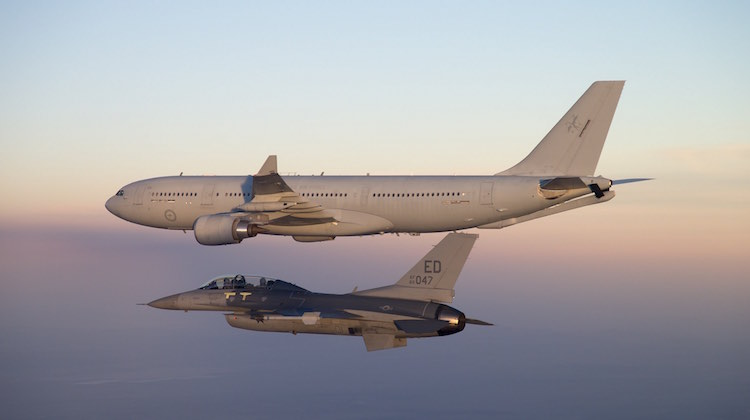 A Royal Australian Air Force (RAAF) KC-30A Multi-Role Tanker Transport (MRTT) with a United States Air Force (USAF) F-16 fighter.