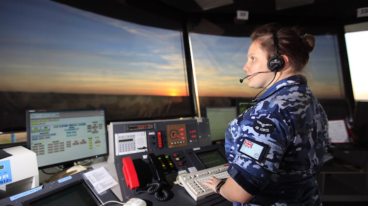 Flying Officer Lauren Parker from No.452 Squadron monitors aircraft movements in the control tower at RAAF Base Tindal during Exercise Pitch Black 2014.