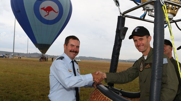 Chief of Air Force, Air Marshal Leo Davies, congratulates balloon pilot Squadron Leader Damian Gilchrist at the launch of the new shaped Air Force Hot Air Balloon at Defence Establishment Fairbairn in Canberra. (Defence)