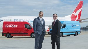 Australia Post chief executive Ahmed Fahour and Qantas chief executive Alan Joyce in front of a StarTrack-branded Boeing 737 freighter. (Qantas)