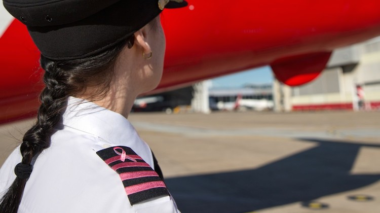 A file image of a female Qantas pilot wearing pink epaulettes in support of breast cancer awareness month. (Qantas)
