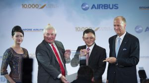 Airbus and Singapore Airlines executives celebrate the 10,000th Airbus aircraft delivery. (Airbus)