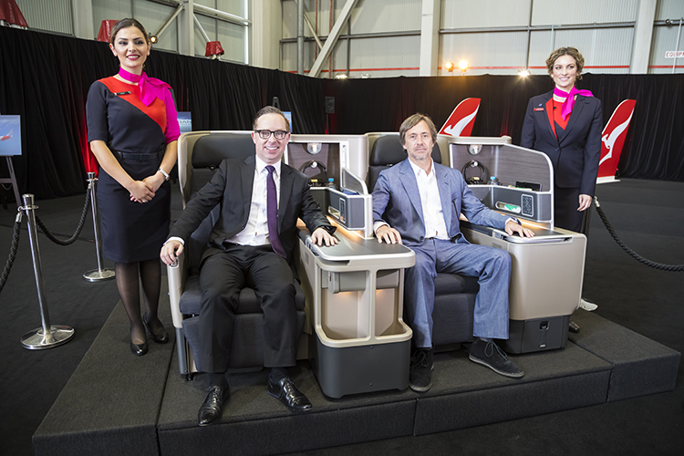 Qantas chief executive Alan Joyce and consultant designer Marc Newson sit in the business class seats to be installed on the airline's Boeing 787-9. (Seth Jaworski)