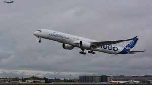 Airbus A350-1000 MSN059, with a chase plane alongside, takes off on its first test flight. (Airbus)