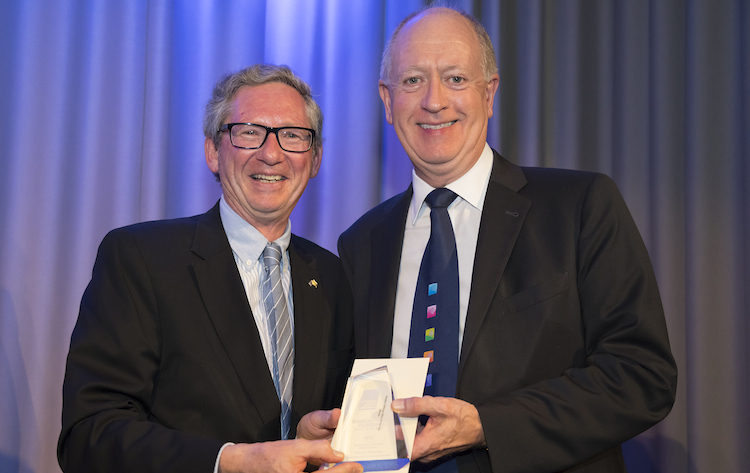 Boeing vice president of international corporate communications Charlie Miller (right) with aviation technical story winner Trevor Thomas from Australian Defence Business Review. (Seth Jaworski)