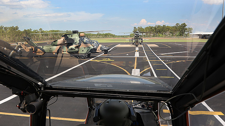 Army's Tiger ARH will conduct FoCFT in February embarked on HMAS Canberra. Note the LHD's deck markings painted on the flight lines at 1 Aviation Regiment's, Robertson Barracks, in Darwin. (Paul Sadler)