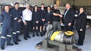 Toll Helicopters' general manager Mark Delaney presents the PT6T engine to Aviation High School's head of aviation Jack Clarke. (Toll Helicopters)