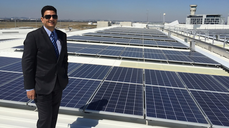 Brisbane Airport general manager for assets Krishan Tangri in front of the solar panels. (Brisbane Airport)