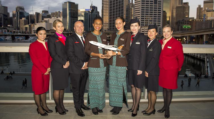 Fiji Airways cabin crew pose with peers from American Airlines, British Airways, Cathay Pacific and Qantas. (oneworld)