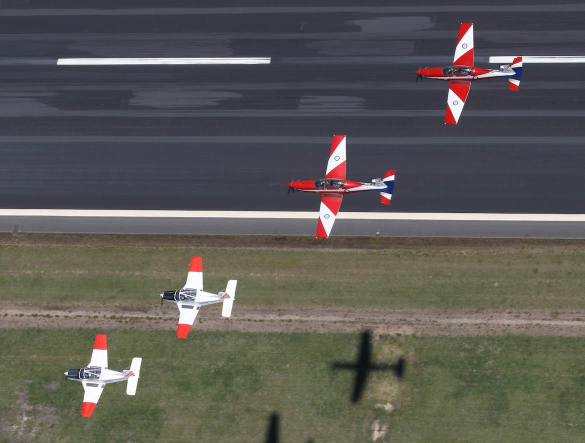 Formation of two CT4's and two Pc9's from Central Flying School over East Sale. (CFS)