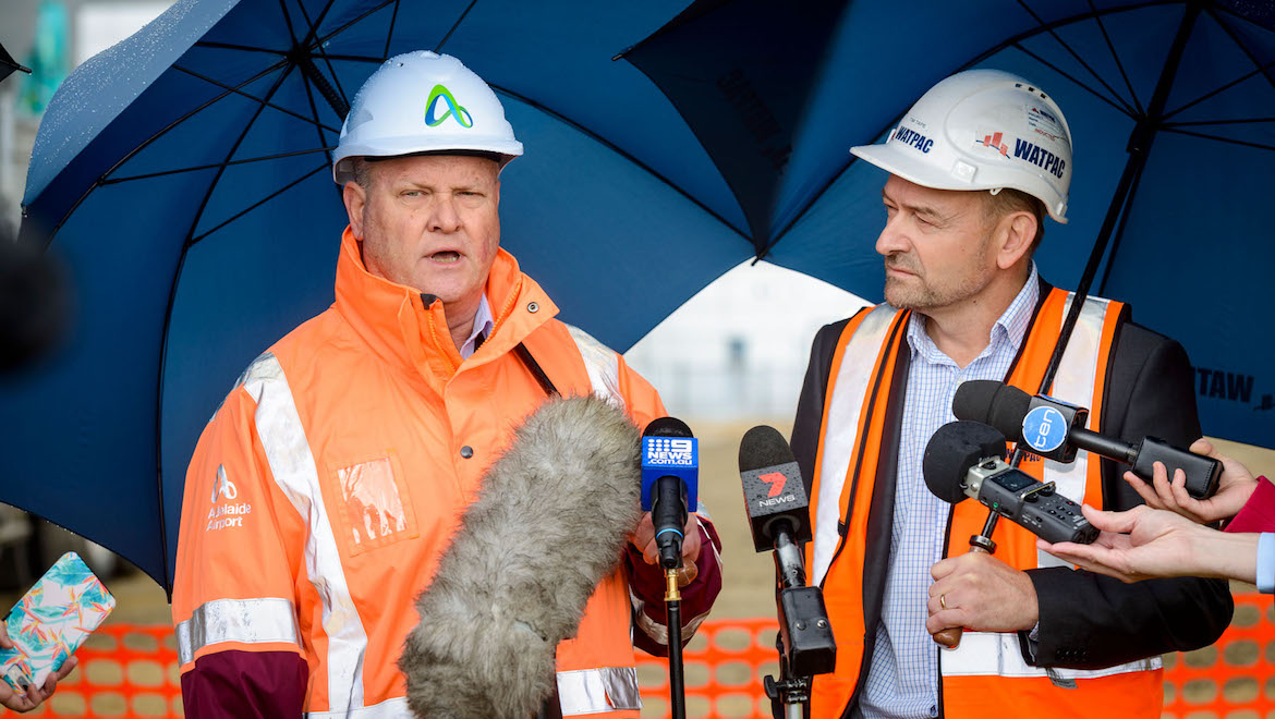 Adelaide Airport managing director Mark Young and Watpac South Australia manager Tim Tape speak with reporters. (Adelaide Airport)