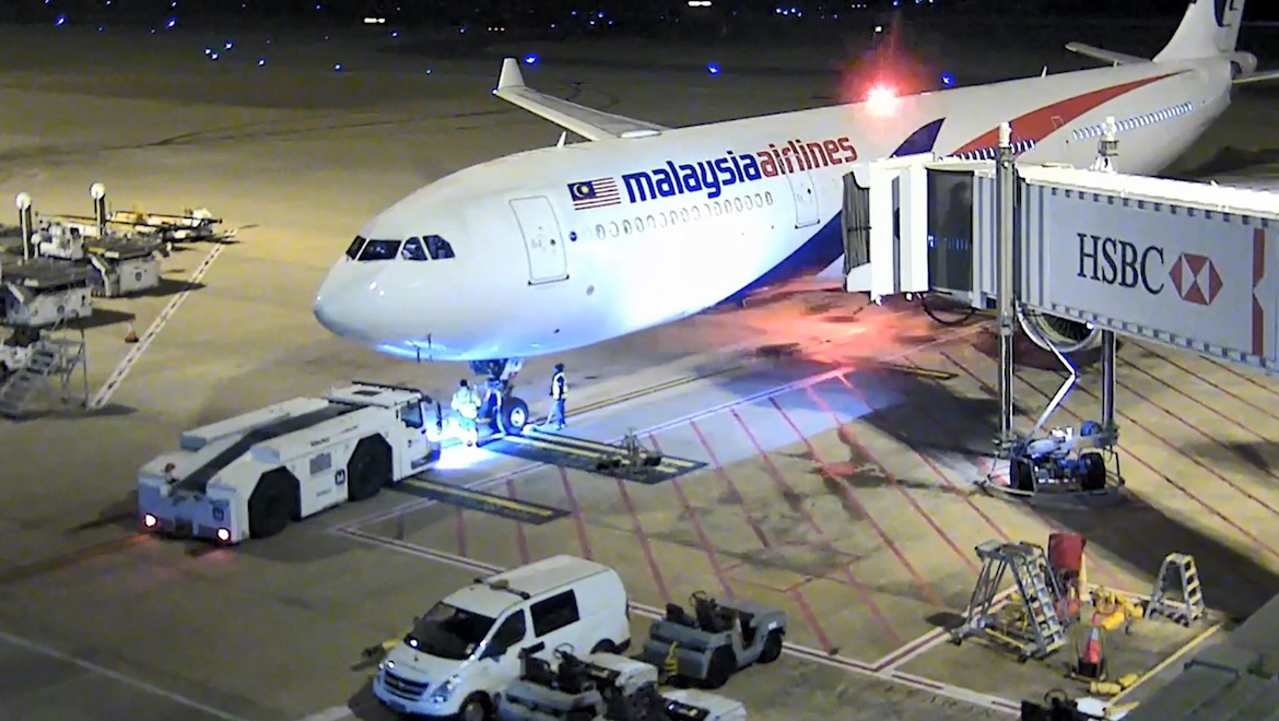 Malaysia Airlines Airbus A330-300 9M-MTK at the departure gate at Brisbane Airport. (ATSB)