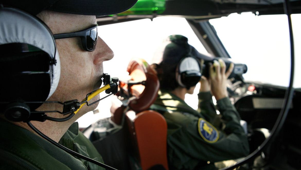 Then FLTLT Marija Jovanovich as aircraft captain on an AP-3C Operation Resolute mission in 2010, with flight engineer WOFF Andrew Skeat looking on. (Defence)