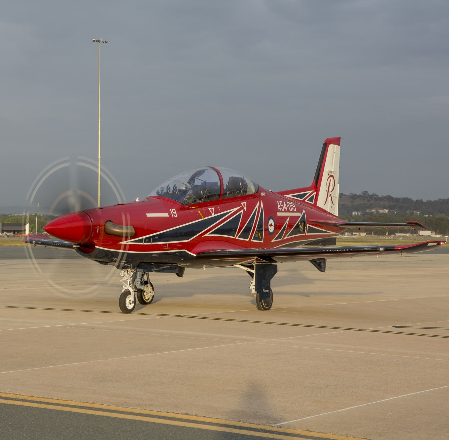 A Royal Australian Air Force PC-21 aircraft on tarmac at Fairbairn preparing to take off. (Defence)