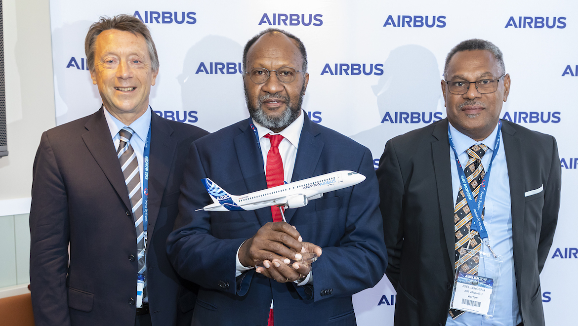 From left Airbus executive vice president for Europe, Africa and the Pacific Christopher Buckley, Vanuatu Prime Minister Charlot Salwai Tabimasmas and Air Vanuatu chairman Joel Lengsau. (Airbus/Seth Jaworski)
