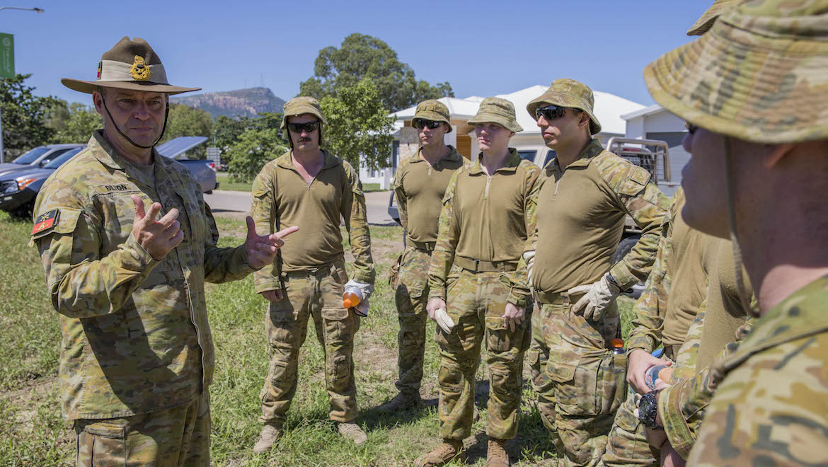 A file image of Major General Greg Bilton speaking with colleagues. (Defence)