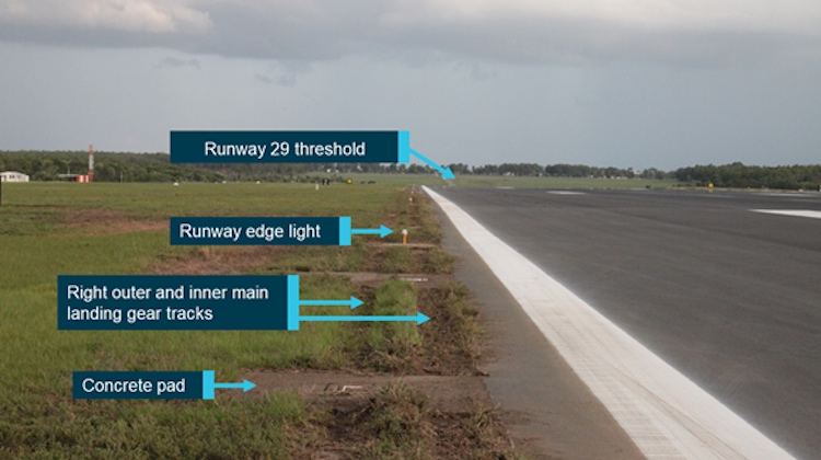 Wheel tracks where VH-VUI departed the runway 29 sealed surface and destroyed runway edge lights. (ATSB)