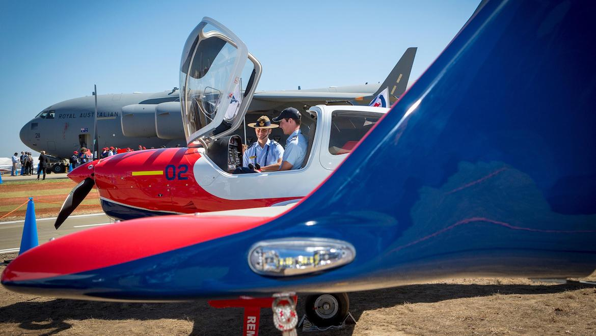 Cadet Warrant Officer (AAFC) Guy St Leon from No. 418 SQN (left), and Cadet Corporal Trent Buckner from No. 405 SQN take in the Diamond DA40 NG at the Australian International Airshow, Avalon. (Defence, CPL Nicci Freeman)
