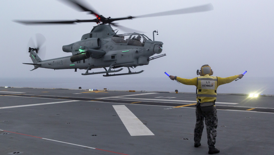 A United States Marine Corps AH-1Z Viper helicopter departing HMAS Adelaide during a multi-spot exercise in 2018. (Defence)