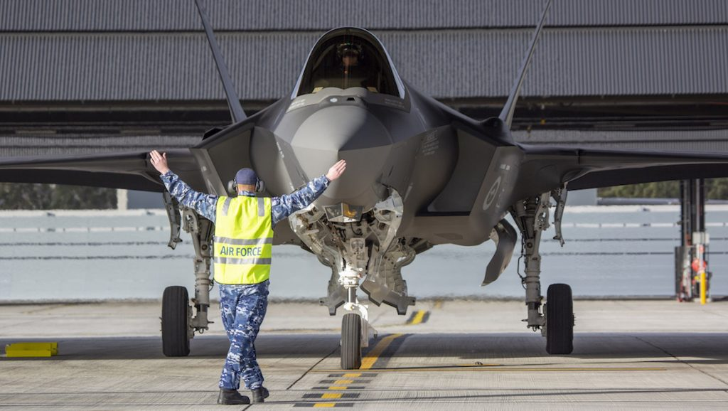 The RAAF's newest F-35A Lightning II aircraft A35-016 is marshalled into position at No. 3 Squadron at RAAF Base Williamtown. (Defence)