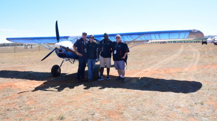 Supervisors pose in front of the completed BushCat that was built over seven days and flown at the Airventure Australia airshow. (Marena Janse van Rensburg)
