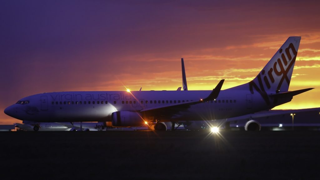 Virgin 737-8FE lines up on runway 34 at Melbourne Airport at sunrise