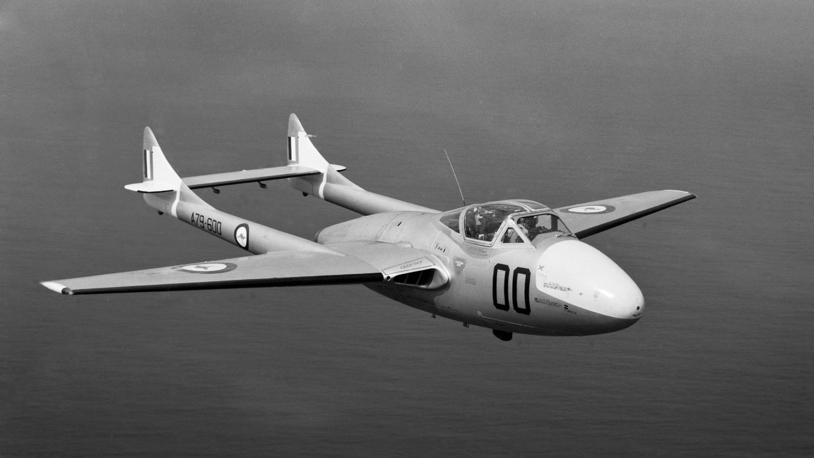 A79-600 DH Vampire (Aust) of CFS flying over the sea. AFIR: 000-140-393